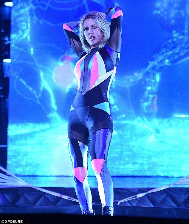 Neon design: She also wore a brightly coloured lycra jumpsuit which showed off her trim frame