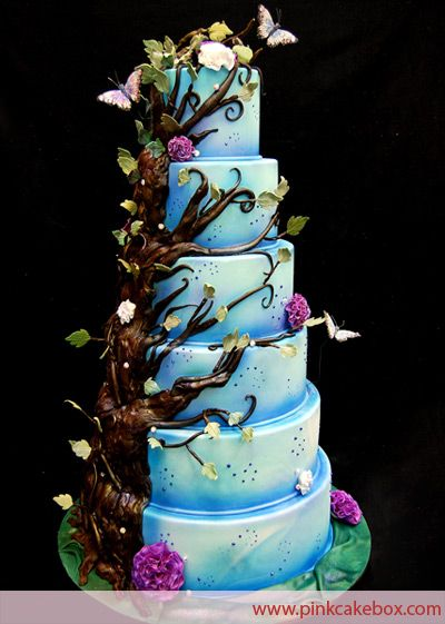 "Forrest Fantasy - The 6 tier cake includes butterflies, purple fantasy flowers and branches growing up the side of the cake. Featured on ""My Fair Wedding"" on WE TV."