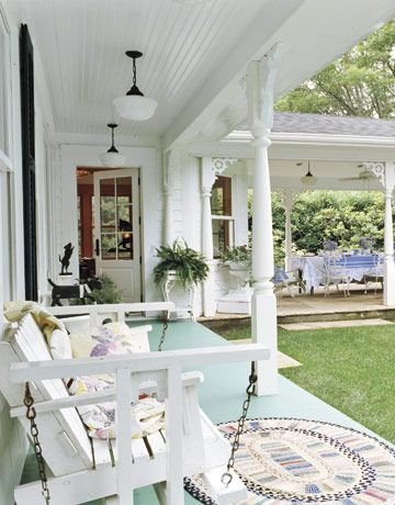 I love Judi Boisson quilts, and I love her home - doesn't it look inviting? This porch is gorgeous - the aqua floor; the vintage schoolhouse lighting, the white glider.  #countryliving  #dreamporch