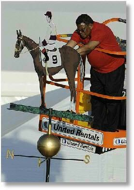 1909. Effendi.  Preakness Stakes winner.  No image found. This image depicts the ritual started in 1909 of painting the winning horse's colors on the weather vane atop the clubhouse at Pimlico. Jockey: Willie Doyle. Winning time: 1:39:80