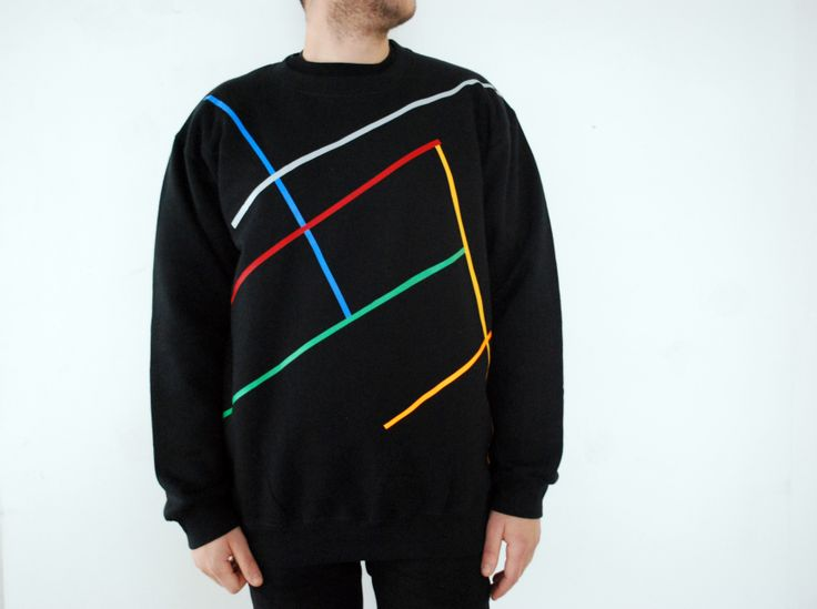 Sweatshirt Color: Black 80% Cotton 20% Polyester Design: Lines that Go