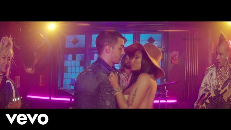 "DNCE - Kissing Strangers ft. Nicki Minaj----------------------------------""Aye, I'm just trying to make my way on through the concrete jungle Who walks with me? Aye, oh yeah, tryna find connection in two-thousand something ain't easy """"Aye, all misinformation open to interpretation Just keep searching me Hyperventilating, blocking up my circulation No waiting"""