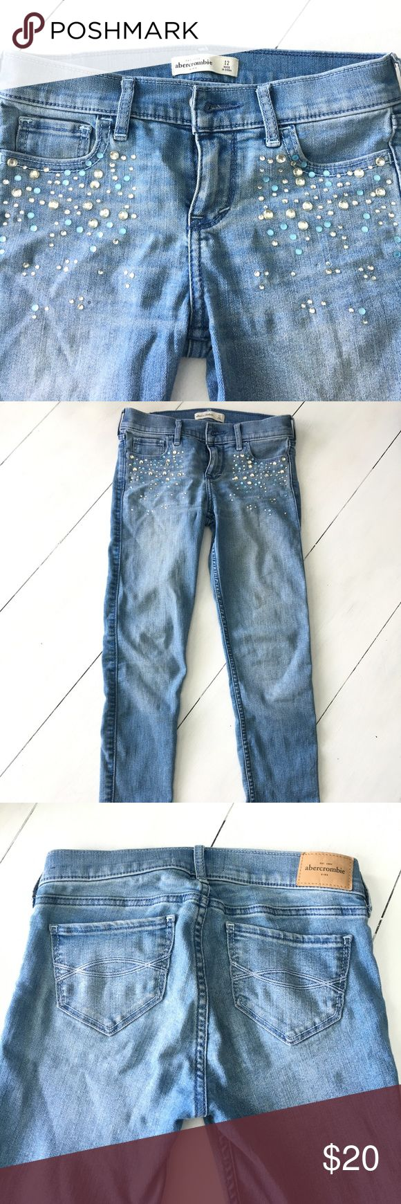 Abercrombie Girls sz 12 Jeweled skinny jeans EUC These jeans are so cute! Great designer look from Abercrombie kids. These are a medium blue wash and Skinny fit. Size girls 12. EUC abercrombie kids Bottoms Jeans