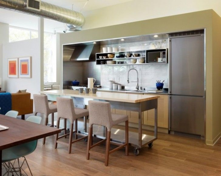 Simple White And Grey Kitchen With Minimalist Island That Have Rectangle Shaped Wood Countertop And Soft Three Stools Ornament On The Wood Flooring