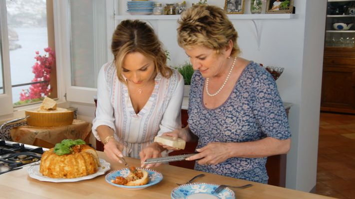 Giada De Laurentiis and her Aunt Raffy dig into Nonna Luna's recipe diary to recreate Sartu Di Riso, inspired by Giada's grandparent's honeymoon on the Amalfi Coast.