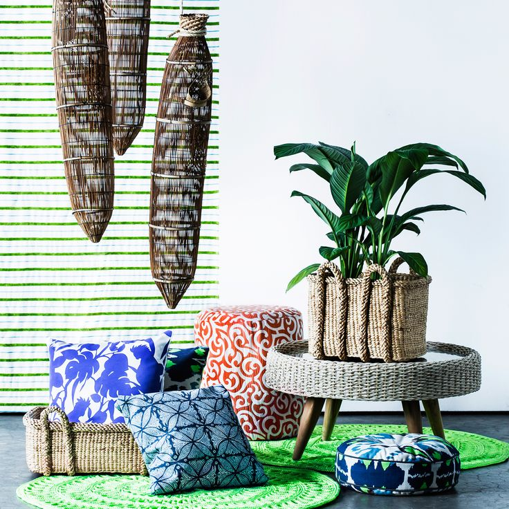 Australian House & Garden's Style Director, Janet James, has used rattan fish traps for a sculptural hanging element in this bright and breezy outdoor living feature. Lime green acrylic rugsand fabulous cushions complete the summery outdoor look.