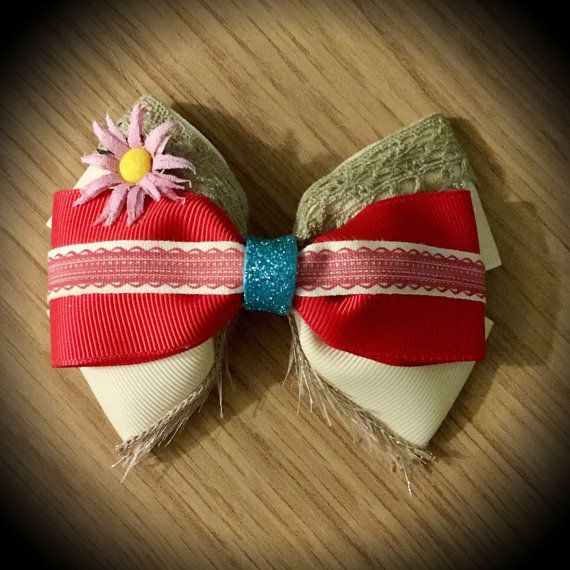 Moana Inspired Disney Princess Hair Bow  Cream and Red Grosgrain Ribbon Decorated with Felt & Crochet. Blue glitter centre and pink flower detail.  Mounted on an alligator clip.  I can do custom bows, just let me know if youd like something specific.  Price is for single bow.