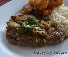 """This recipe is a riff on the simple Cuban dish called """"bistec de palomilla."""" It is good, simple home cooking at its finest and turns a cheap cut of meat into something tender and tasty. The featured meat is cube steak, which is one of the cheapest cuts I can get from my local grass fed beef farmers, so it is also a great way to eat healthy grass fed beef on a budget."""