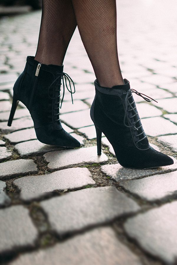 Carvela elevates the classic ankle boot with a luxe suede finish, pointed toe and faux-lace tie that fastens with a concealed zip. Wear to lend a modern spin to a knitted skirt this winter.