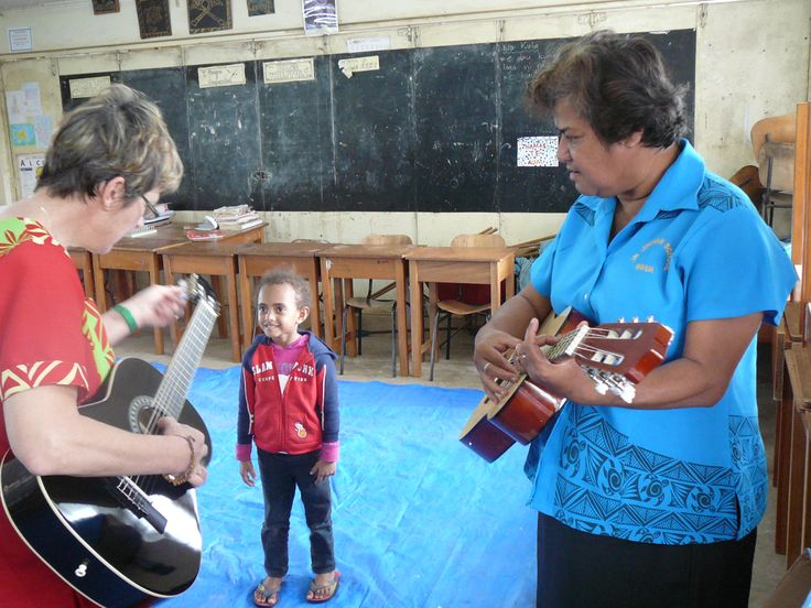 teaching the guitar tuning process to the head teacher