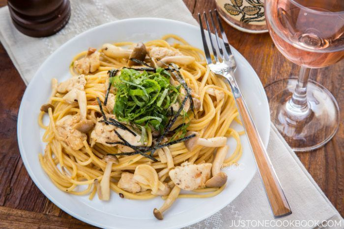 Tasty Japanese style (wafu) pasta with chicken tender, shimeji mushrooms, and umeboshi, garnished with shiso leaves and shredded nori.