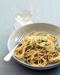 Spaghetti with Anchovy Carbonara   Chris Cosentino adds briny flavor to his pasta with cured tuna heart. He shaves it on right before serving. This simplified recipe calls for anchovies, rather than the tuna heart Cosentino uses. Egg yolks form a silky sauce.
