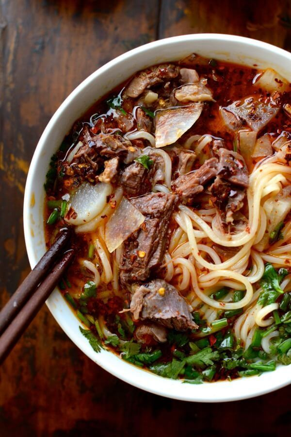 Lanzhou Beef Noodle Soup (兰州拉面) consists of flavorful broth,shaved beef,tender radishes,herbs,chili oil, and chewy noodles and is the best beef noodle soup!