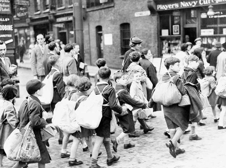 SEP 8 1940 Direct hit on shelter kills 78 people Young children from the East End of London carrying their belongings, including their gas masks, as they set off on their journey to safer areas.
