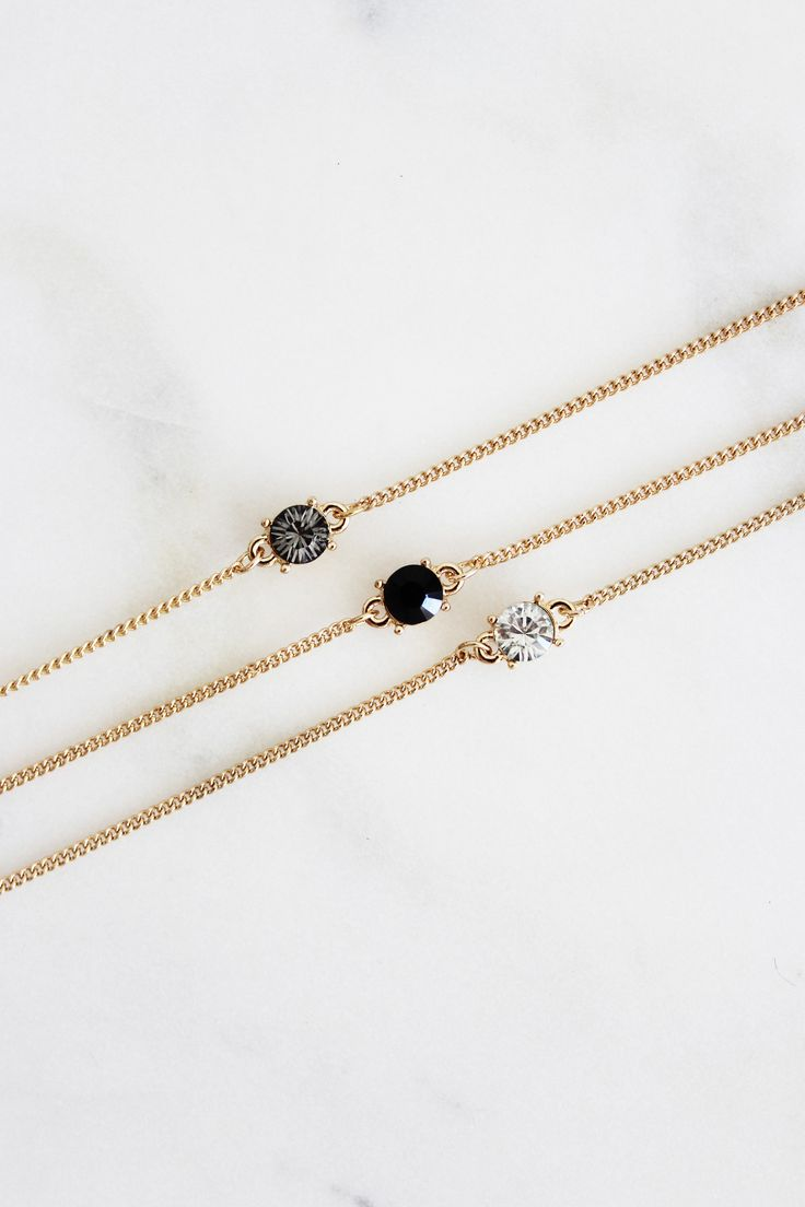 Set of three faux stone adjustable chokers. Layer them up or use them separate.