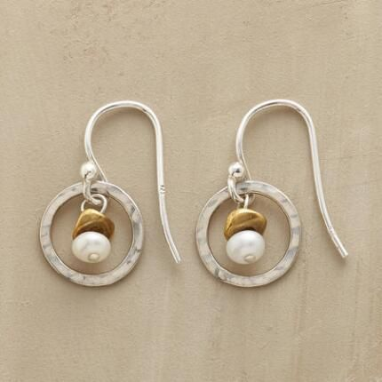 """EVERYWHERE EARRINGS - Casual or dressy, these earrings shine with hammered sterling circles in which a brass-topped pearl sways sweetly. Sterling silver wires. Exclusive. 3/4""""L."""