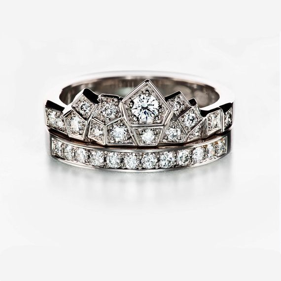 Matching ring set with white gold engagement ring and wedding band with diamonds. Unique and modern design ring and half eternity ring.