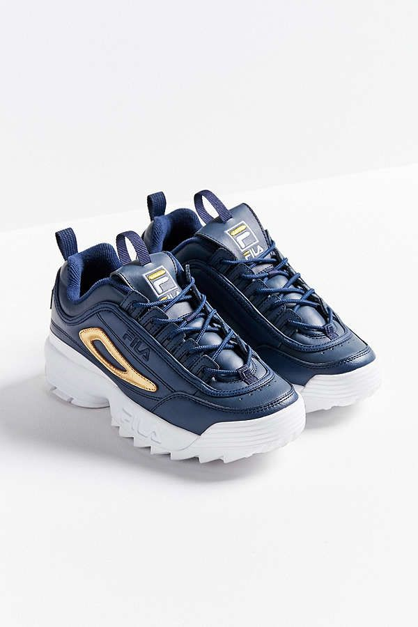 38ff5d83a92 Fila Disruptor II Offered In Black And Gold At Urban Outfitters