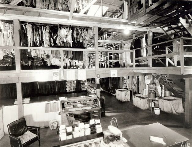 If the walls of this place could talk, they'd tell us 10,000 stories—literally! This is the Ladies wardrobe department at MGM Studios, Culver City. It was three stories tall, which isn't surprising because by the 1960s, it had around 300,000 costumes in storage, and that's not counting the ones it had discarded over time. I can only imagine the complex system they had in place to keep a track of all these items!
