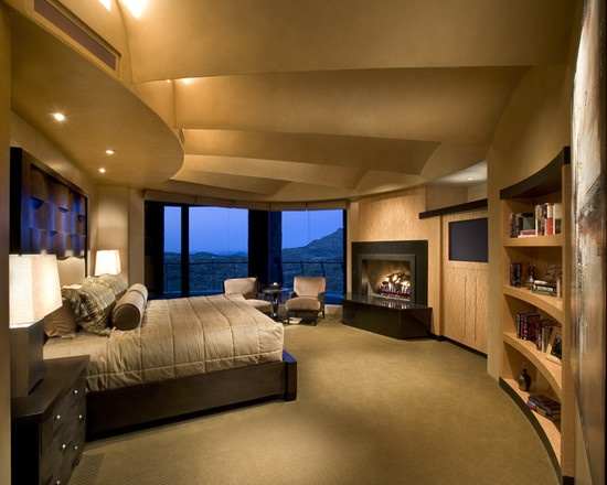 Interesting shaped bedroom with fireplace tv and built for Bedroom ideas to boost intimacy