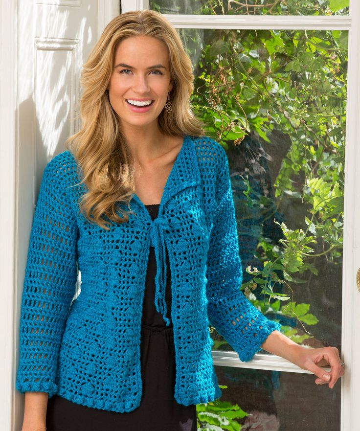 Crocheted bobbles and lace combine to make a lovely cardigan that will span the seasons. The cardigan has a tie closure, and is finished with three-quarter length sleeves.