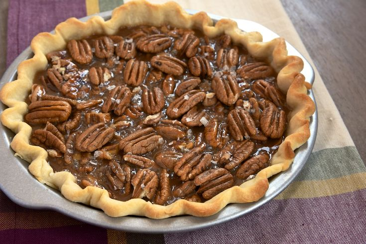 Salted Caramel Pecan Pie combines crunchy pecans and rich, salty caramel for an unforgettable pie experience.