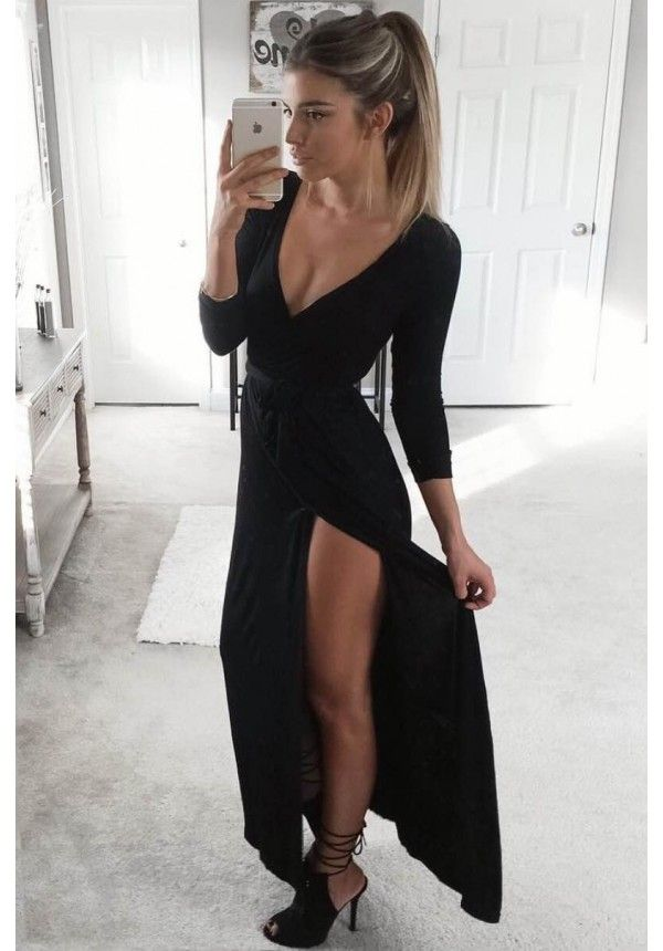 Farrah black maxi dress with plunging neckline and high leg slit.