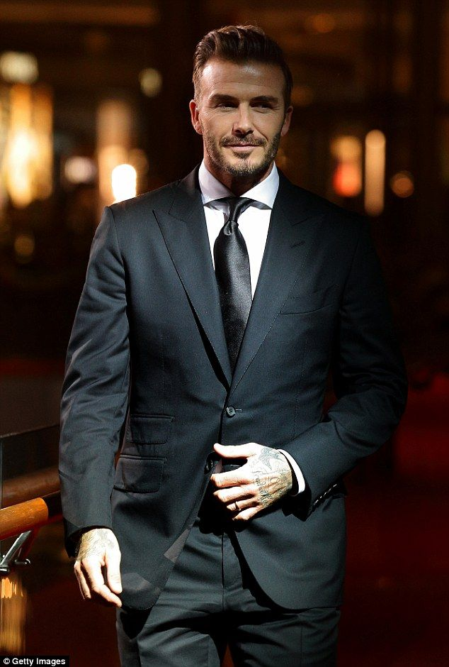 The name's Beckham: David Beckham proved he was truly worthy of the title as he arrived at the 26th Singapore International Film Festival gala dinner at the Marina Sands Hotel on Saturday