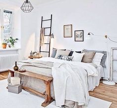 Beautiful bedroom decoration with a bed, cushions & colorful pillows & a white rug on the wooden floor, a wall canvas gallery as well as other elegance accessories. It's a modern and classic bed room decoration idea. http://www.urbanroad.com.au/