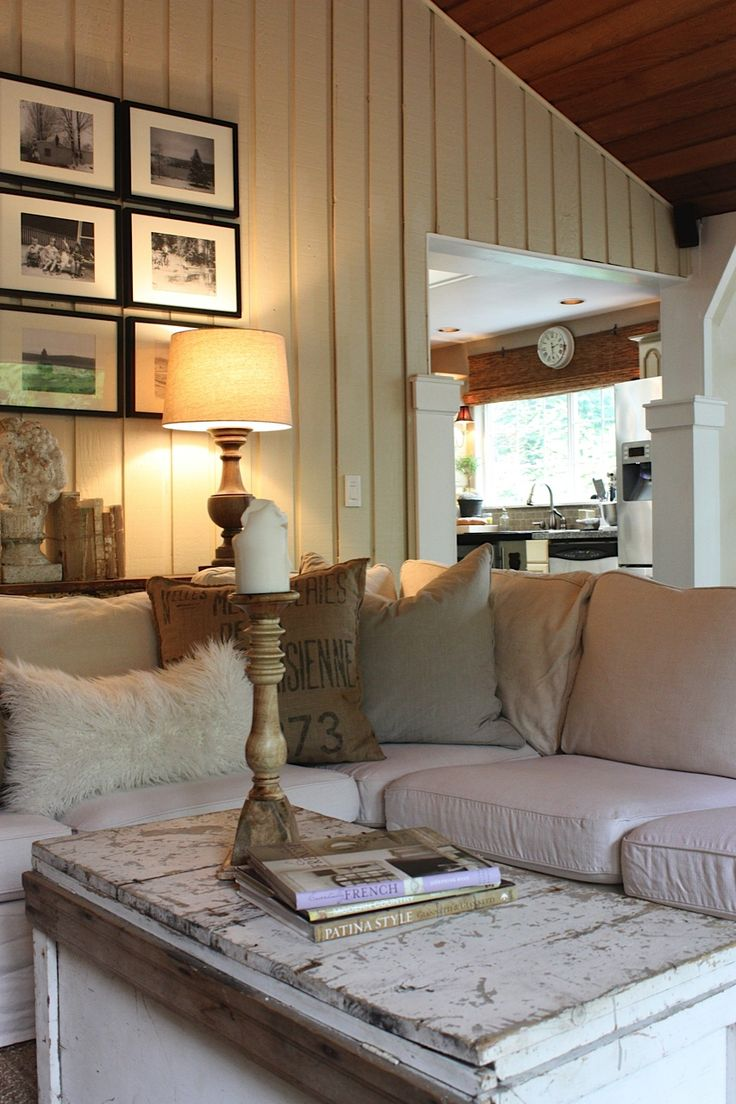 Neutral, painted wood-paneled den with neutral accessories. I wish the wood-paneled ceiling was a lighter color.