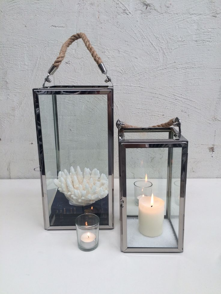 Stainless steal lanterns  Presented here with vintage book, coral and candle.  Many other themed options available