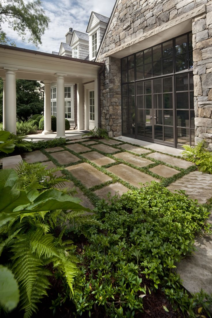 Courtyard terrace with limestone pavers by Howard Design Studio.