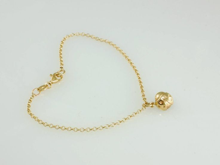 Ladybird Bracelet. NZ299 9ct Gold. Matching to our cute beetle earrings we also created this delicate bracelet with beetle charm.  Also available in stud earrings in silver and 9ct yellow gold. Made in our Nelson workshop in 9ct yellow gold. Jewellery made @jewelbeetle in Nelson New Zealand.