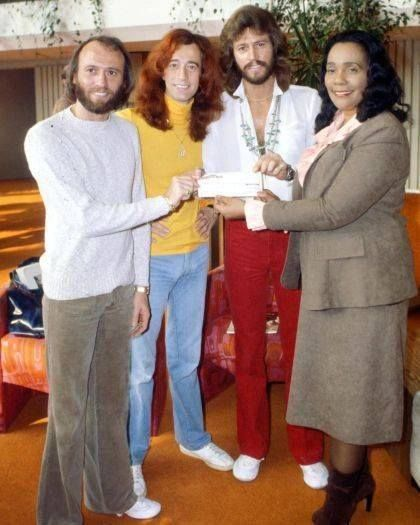 Bee Gees presenting a check (donation) to Coretta King for the MLK Center
