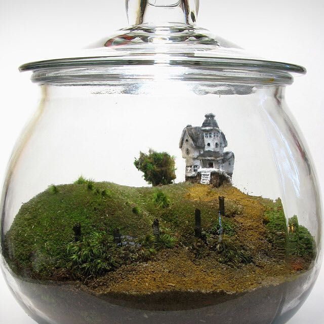 BEETLEJUICE TERRARIUM   The best movies create new worlds that we get to visit for short periods of time. The Beetlejuice Terrarium by Etsy seller Face of the Earth takes one of these worlds — that of Beetlejuice — and scales it down so it can fit in your office, den, or pretty much anywhere else you like. Created using moss taken from a forest near the artist, the placement of the tree, posts, and driveway are all accurate relative to the house, which is made out of wax, stands 1.5-inches…
