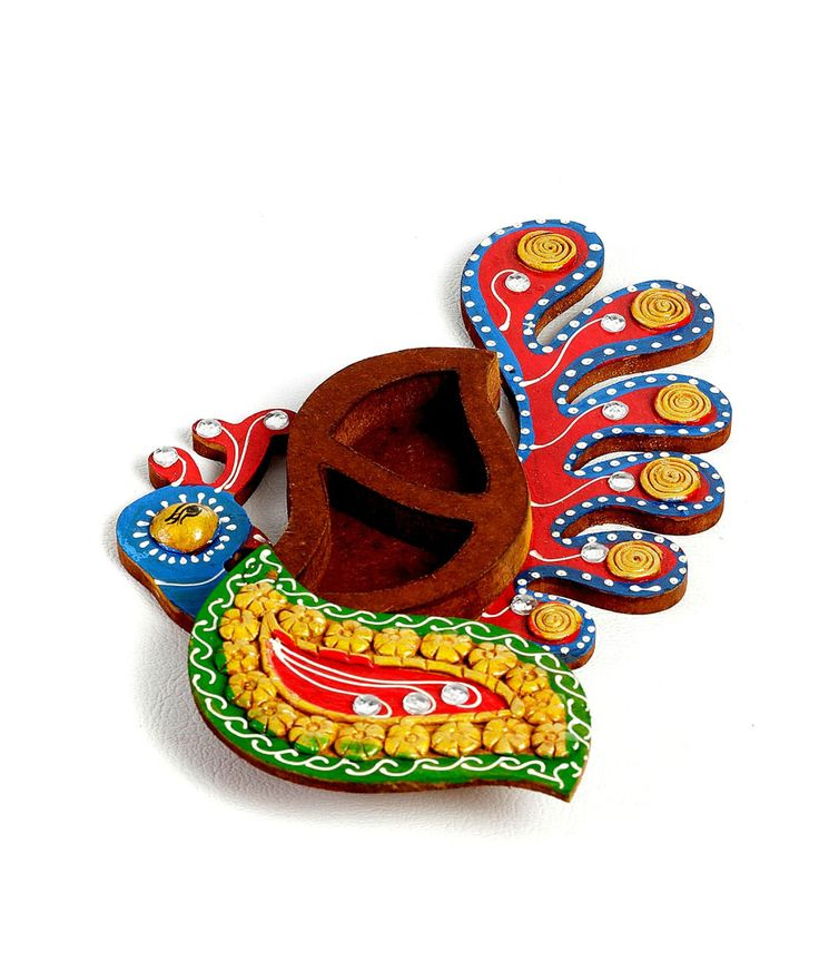 Twist and open this Kumkum Box in a Peacock Design in wood and clay. Hand painted with bright hues of Blue, Red and Green and studded with clay florets and studded with clean kundans for a gleaming look. The art is intricate Mehendi like work where clay is applied delicately on wood just like Mehendi is applied neatly on hands with all concentration and dedication.fashionandyou.com brings to you artefacts from Aapno Rajasthan that shall leave you within a mirage of exquisiteness. The expert…
