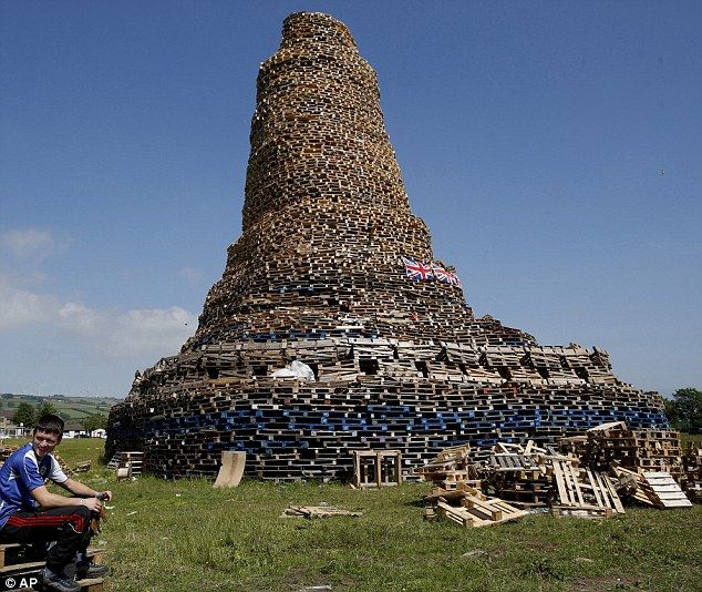 This bonfire is more than 100 feet high in the New Mossley area of Belfast. Hundreds of bonfires will be set alight at midnight Thursday as Protestant loyalists celebrate July 12