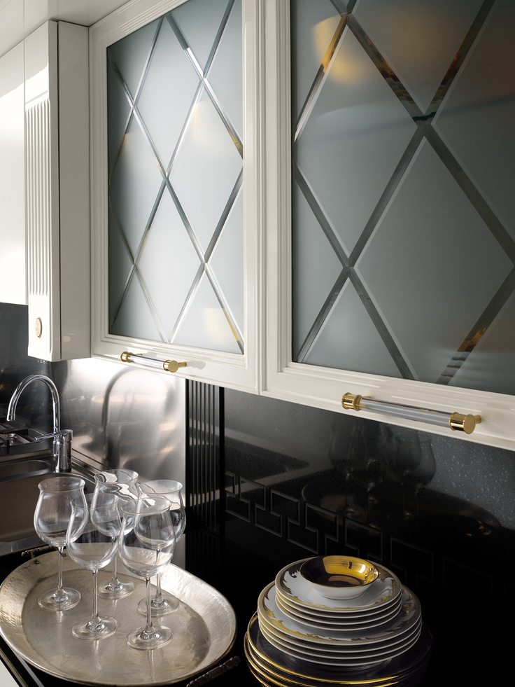 Elegant Shapes Gleaming Lacquer Figured Glass Brass Finishes And Quarz Work Tops Classy Choices For A Kitchen Where Familiar Values Symbols Merge