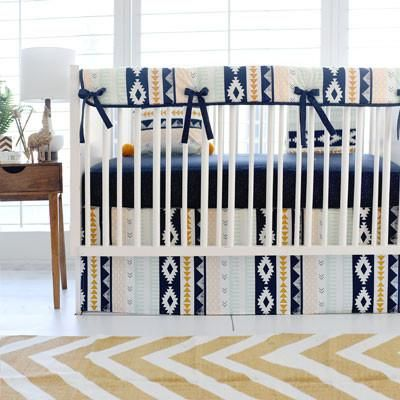 This adventurous crib skirt features a fun aztec pattern that gives off a western vibe. Perfect for a baby boy's nursery! Crib Skirt Features: • Drop length is