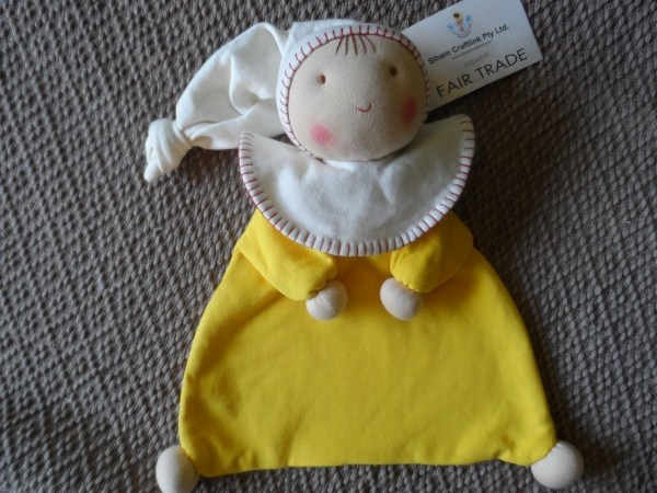 An adorable soft comforter made from organic cotton.   The hands and feet are actually firm little knobs - great for when babies are teething.   This is an exceptionally adorable cuddly- one a child will truly love.   As each doll is handmade, each doll is unique.   The story of the fair trade producer group accompanies each doll.