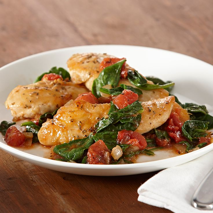 Ready in 30 minutes, this skillet chicken dish features good-for-you tomatoes and spinach. Serve over pasta or couscous.