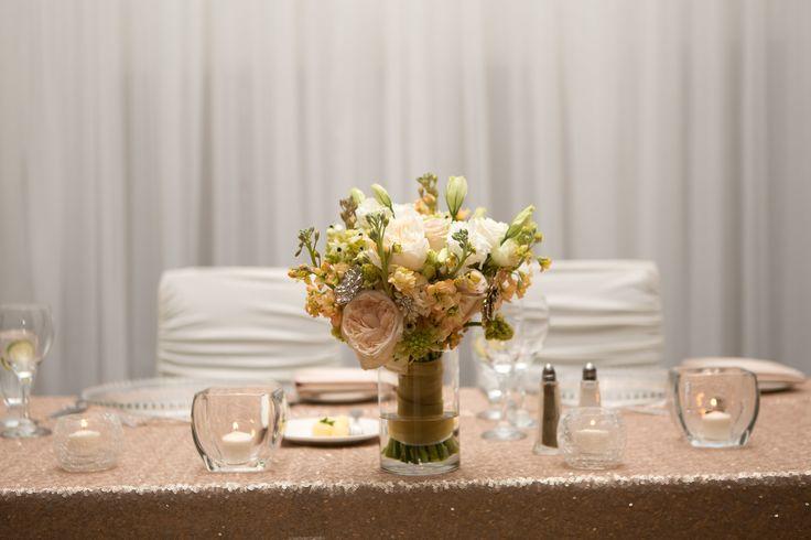 Flowers: @facheflorals || Photo: @amarie_photo || Head Table Glitter Linens, Bride Bouquet as Centerpiece