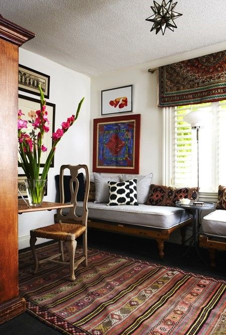 Tapestry rug used as window treatment.  So cool....just love this room, eclectic and warm.