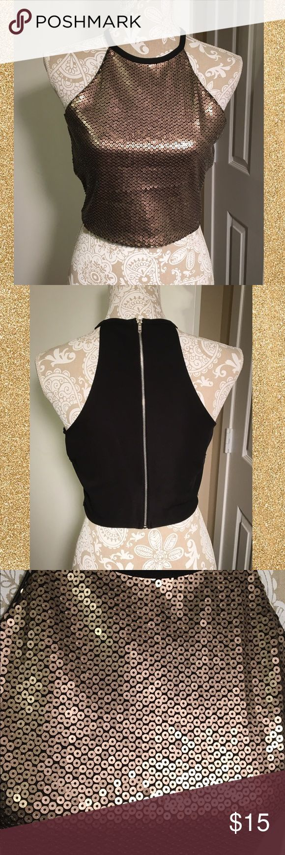 NWT gold sequin halter back zip crop top NWT gold sequined (front) & black full zip back sleeveless racer back crop top. Size Medium. Has some stretch 95% poly 5% spandex. Super cute for summer night parties or music festivals. Dress up or down. Fully lined so shouldn't be itchy. Brand new. Smoke free home. #nwt #new #crop #gold #black #sequin #medium #summer #zip #stretch ❌no trades❌ one clothing Tops Crop Tops