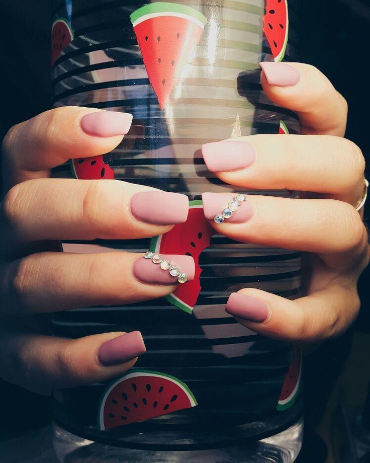 Gel nails. Matte. Dark pink with rhinestones