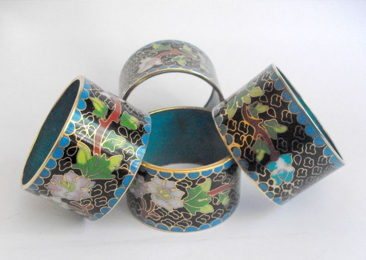 011330 £25 inc UK post. Offers welcome. Four matched vintage oriental cloisonne napkin rings with floral decoration and blue enamelled interior. For further info/photos, please contact us.