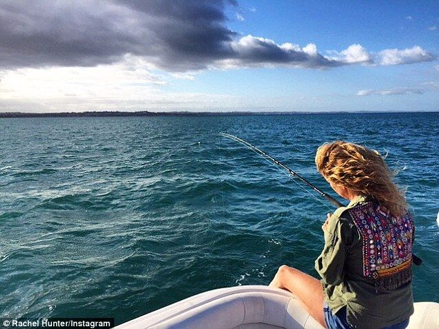 'The day I fed the fish': Supermodel Rachel Hunter, 47, made sure to take things easy this week by kicking back for a boat-bound fishing trip on Tuesday