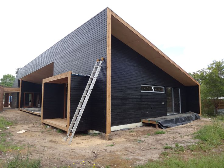 All white cypress cladding complete! Looking sharp.