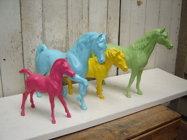 CRAFT: Create a quirky and colorful decoration by repurposing old model horses by painting them with bright colors. Go a step further and attach them to a block of wood or a brick painted to match to create a custom bookend.