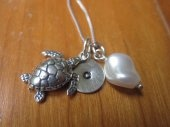 Ocean dreams sterling silver necklace with sea turtle and small initial of your choice